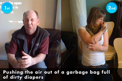 Pushing the air out of a garbage bag full of diapers